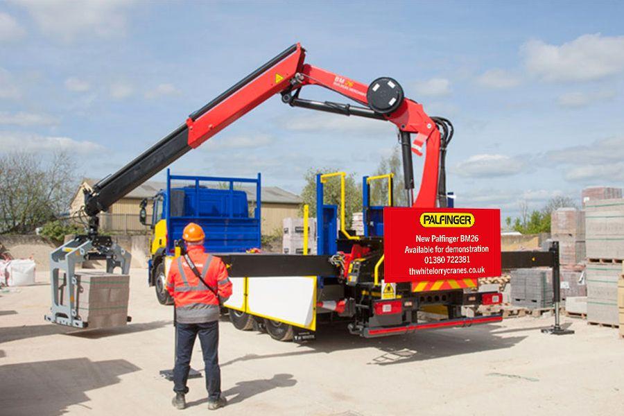 Palfinger BM26 Builders Merchant crane in merchant yard with operator lifting blocks