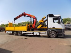 Palfinger crane and pile driver on custom truck body